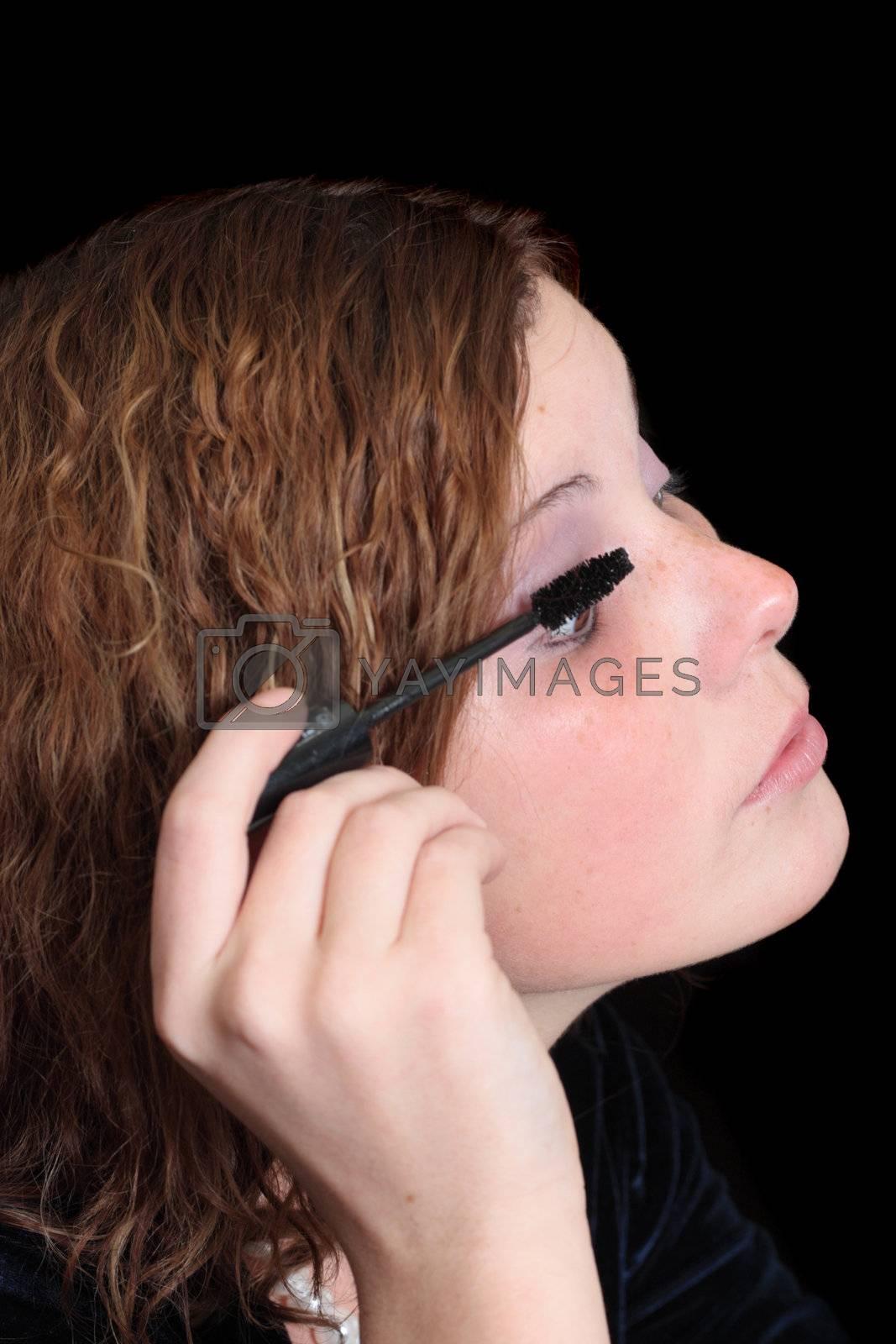 girl apllying make-up