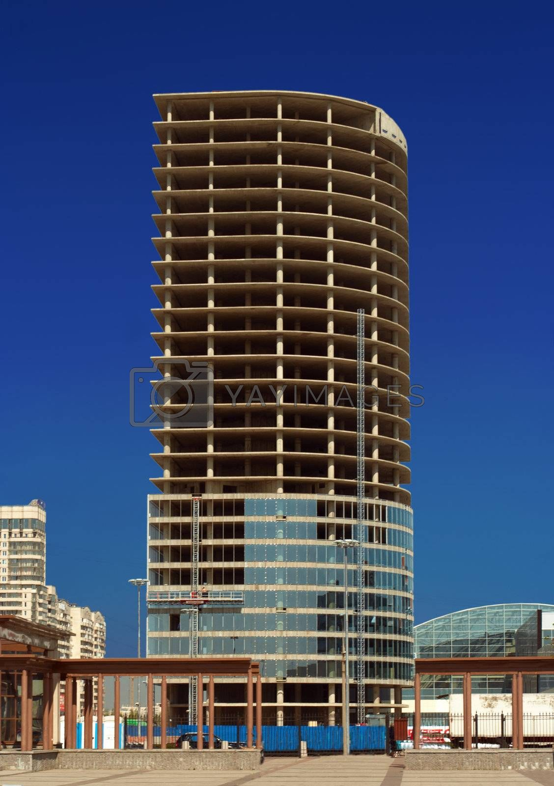 Construction of office building on a blue sky