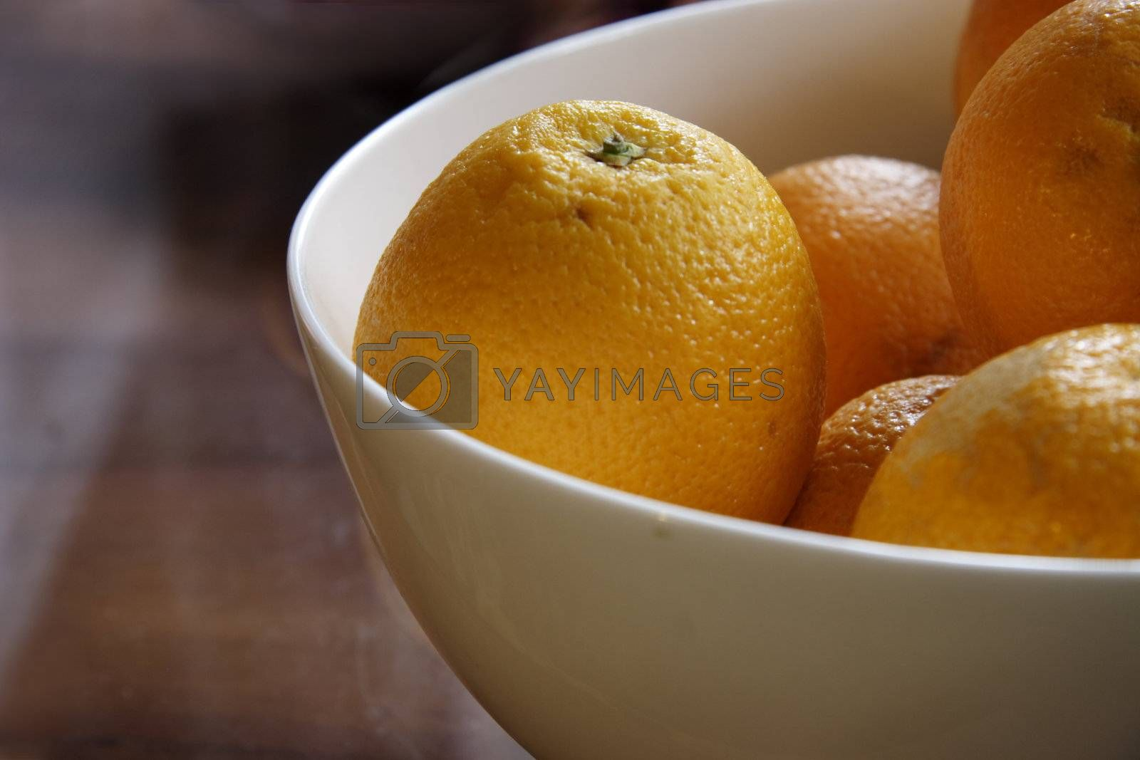 fresh oranges in a china bowl taken with natural light