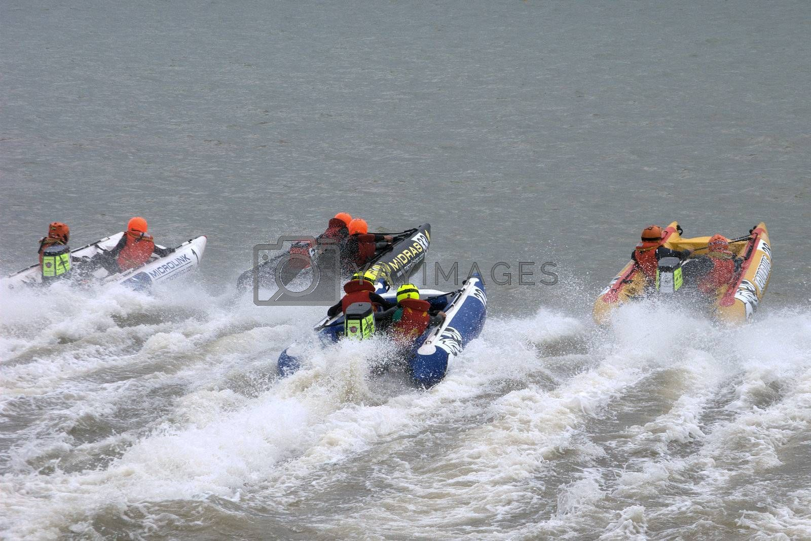 Group of inflatable power boats racing