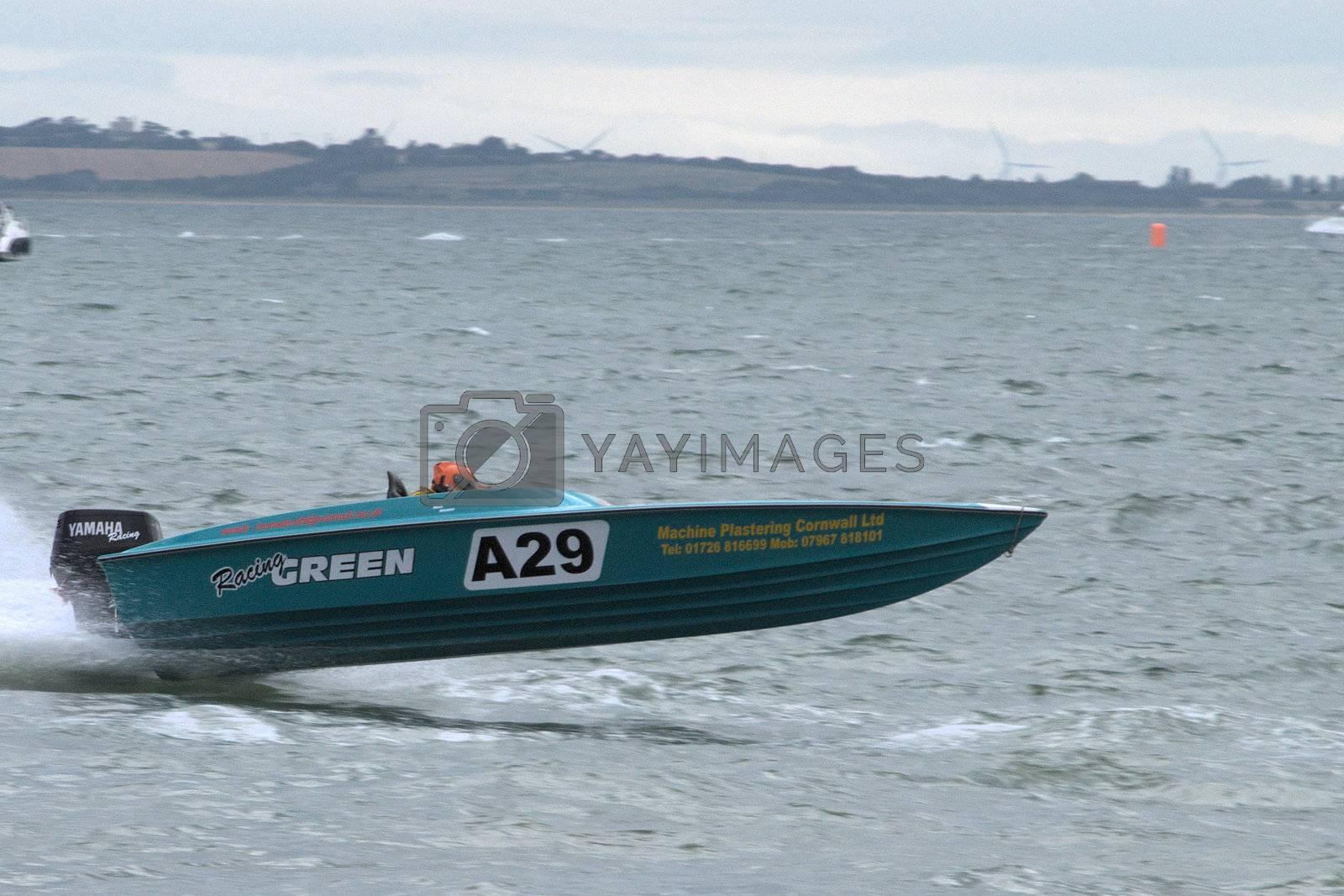 Blue power boat racing