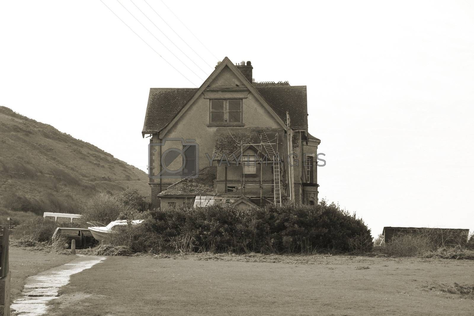 spooky old house by leafy