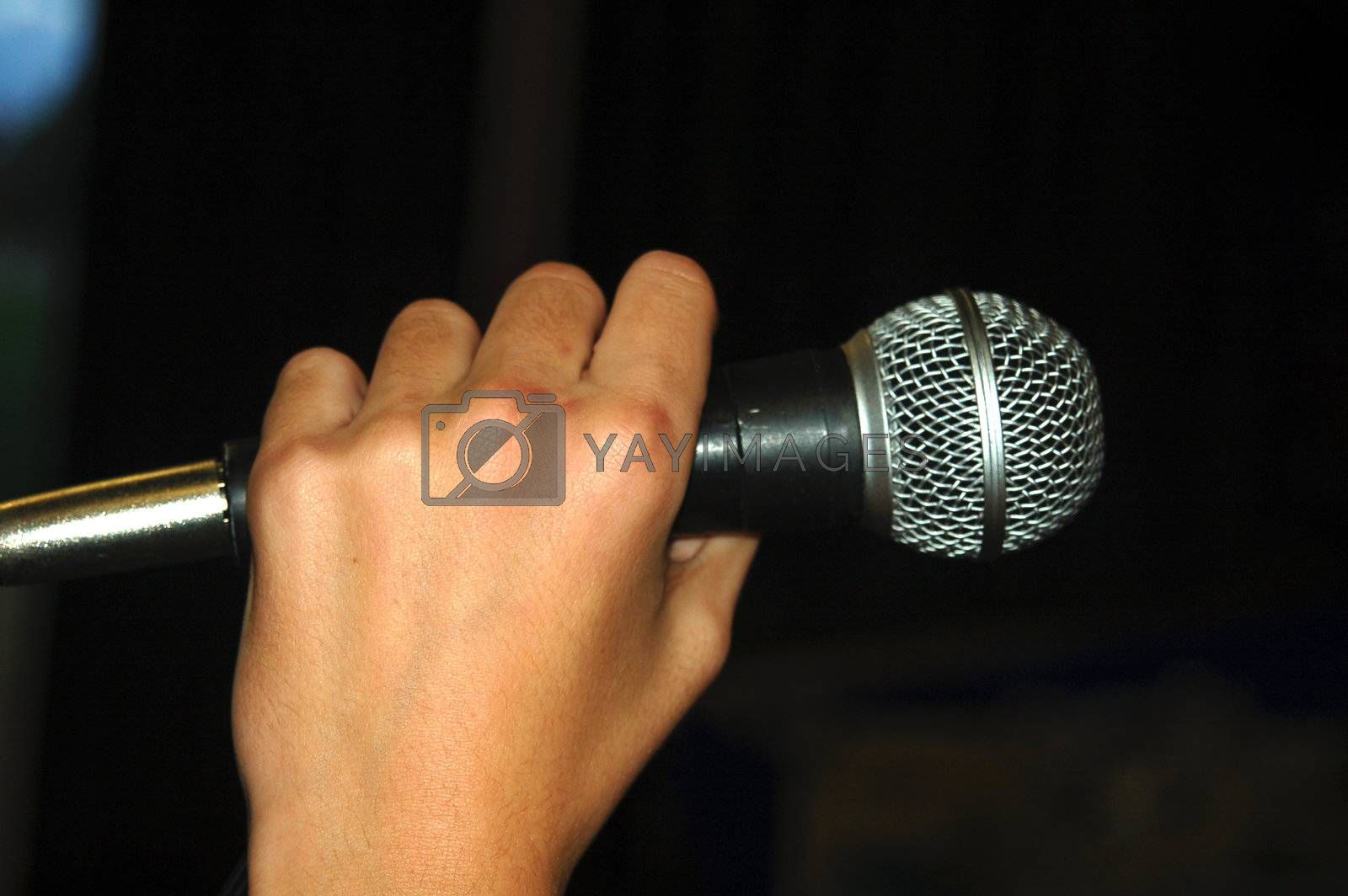 Royalty free image of Hand Holding Microphone by thelongwayround