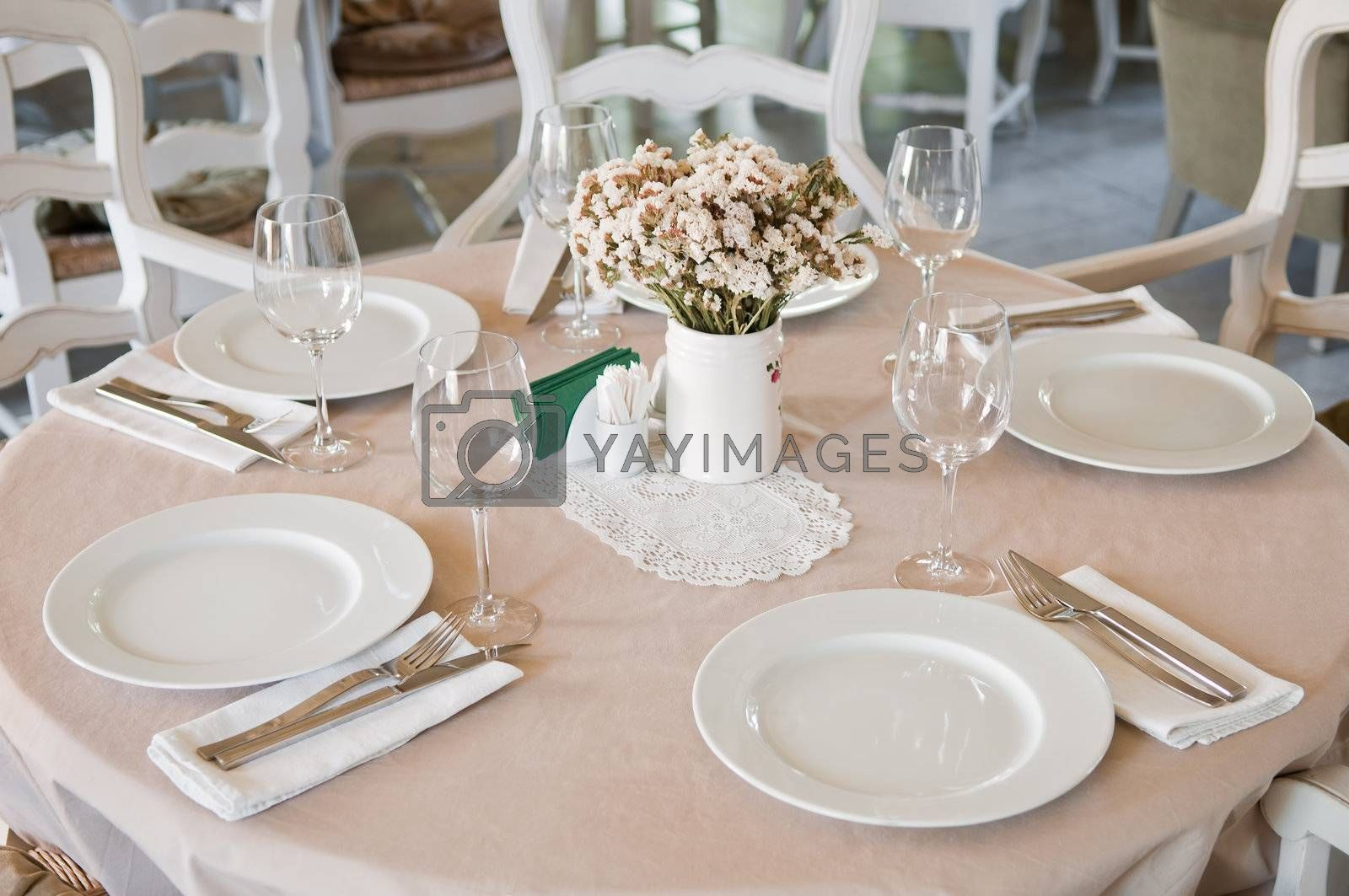Royalty free image of Fine Crystal Table Setting at a Restaurant by shivanetua