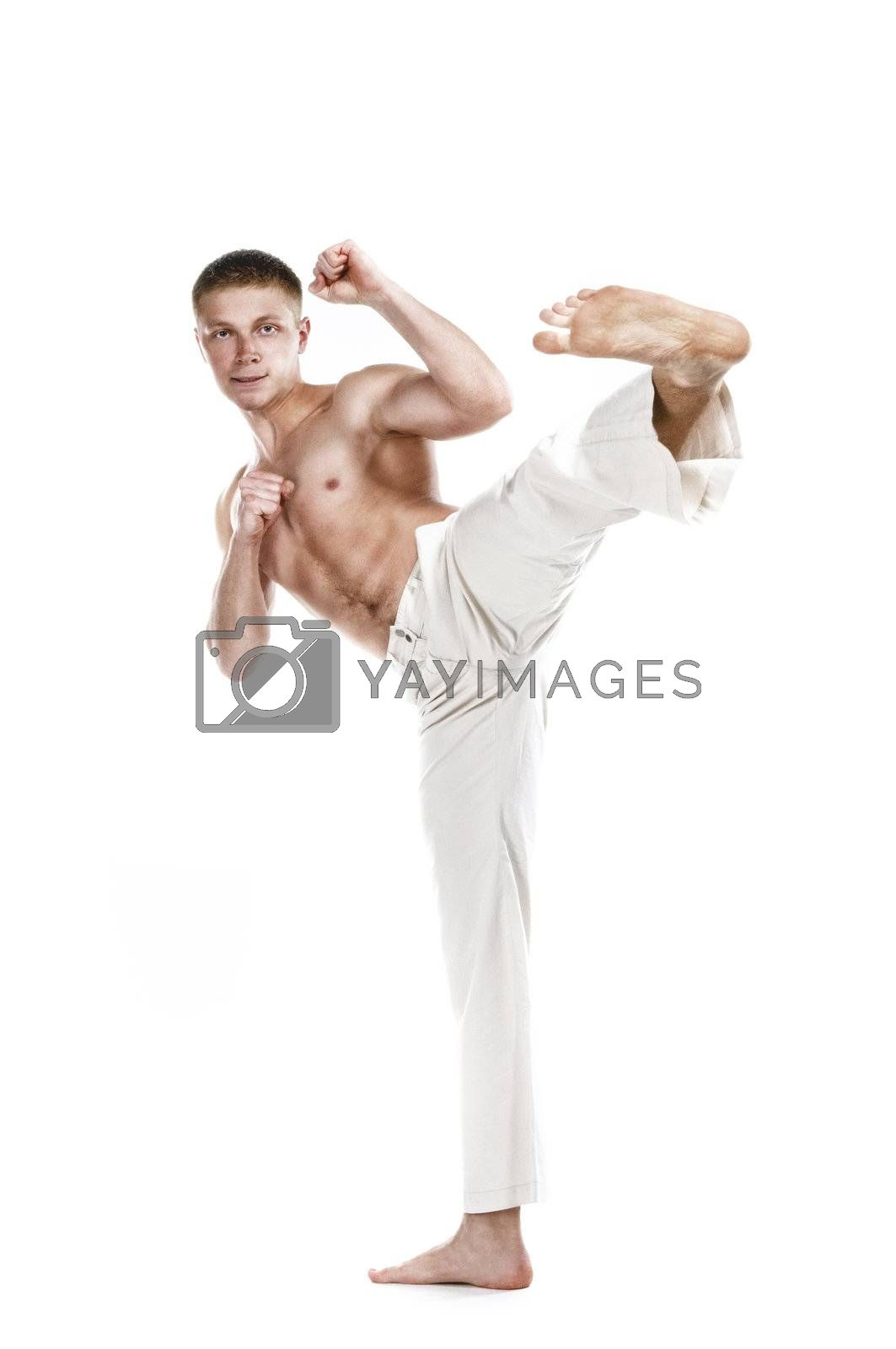 Royalty free image of Street figter kicking with the leg by shivanetua