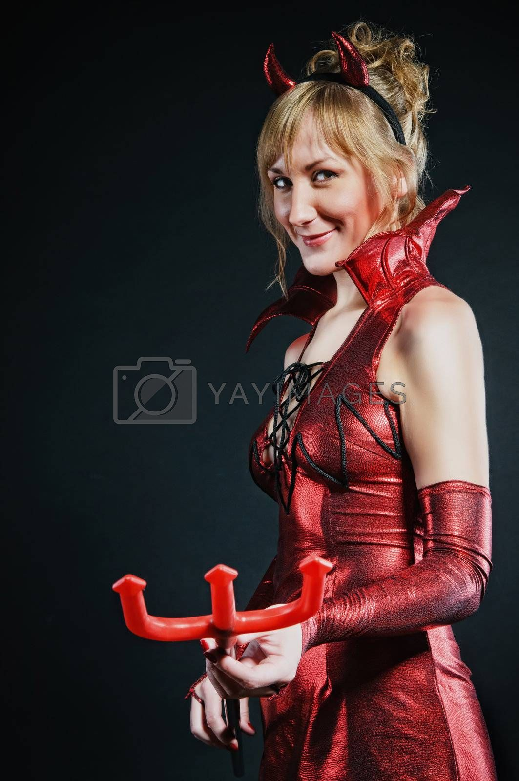 Royalty free image of Red devil woman by shivanetua