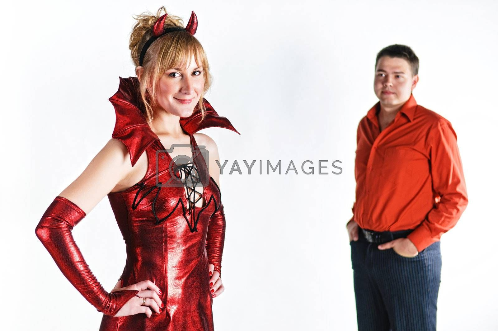 Royalty free image of Red devil couple by shivanetua