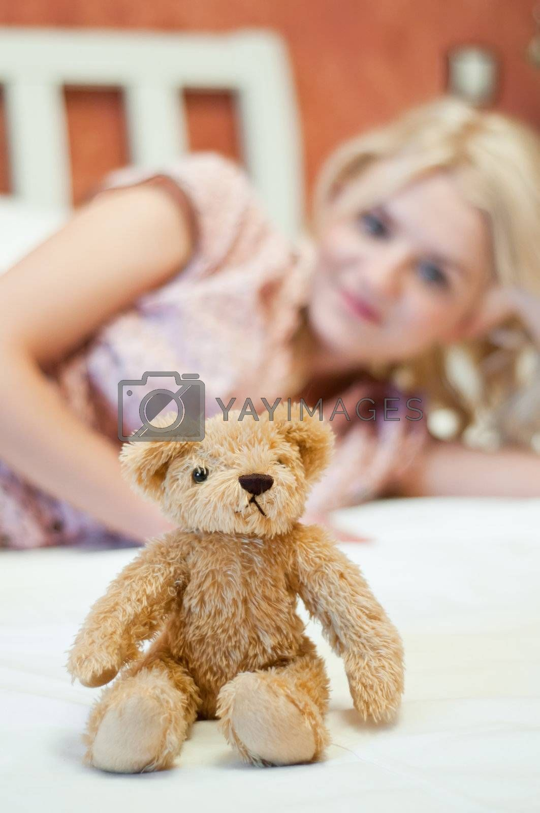 Royalty free image of Beautiful young girl with toy by shivanetua