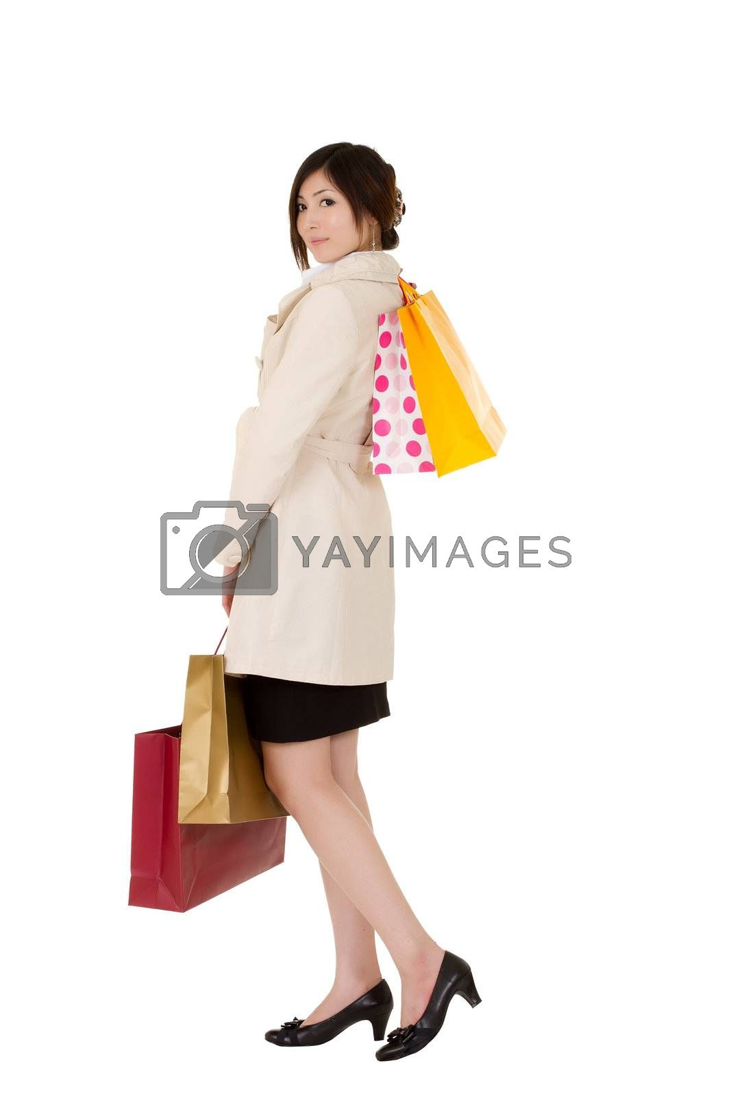 Royalty free image of Young lady shopping by elwynn