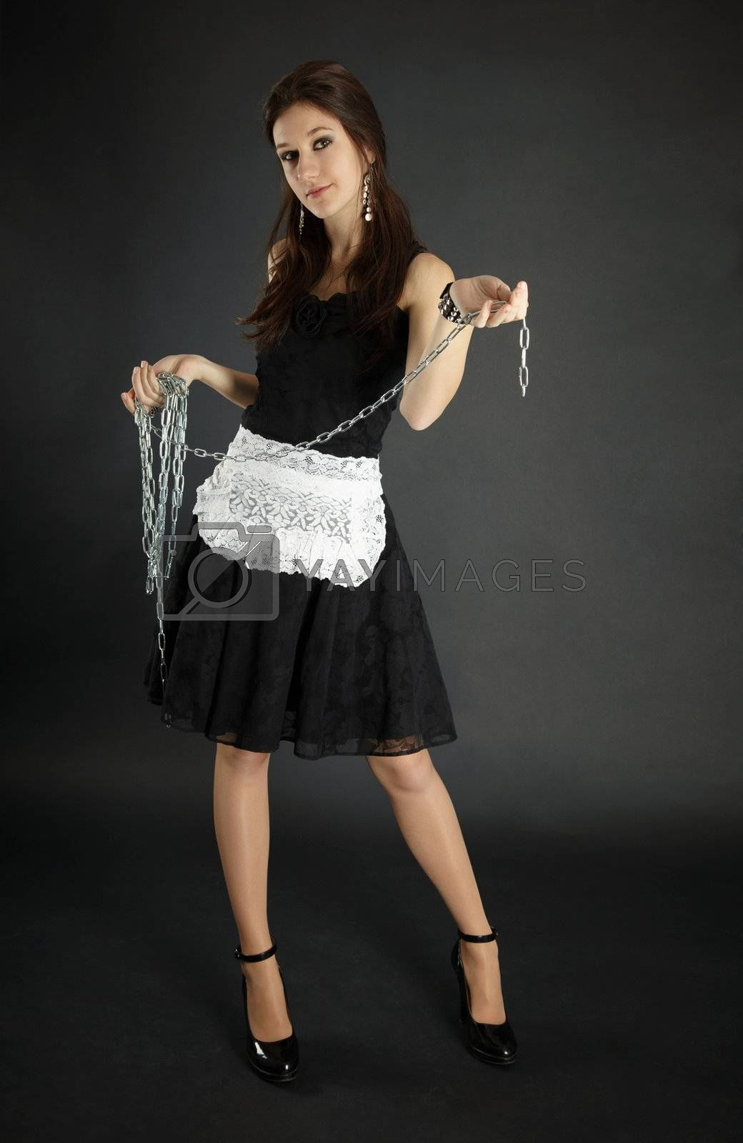 Royalty free image of Woman in maid costume with chain by pzaxe