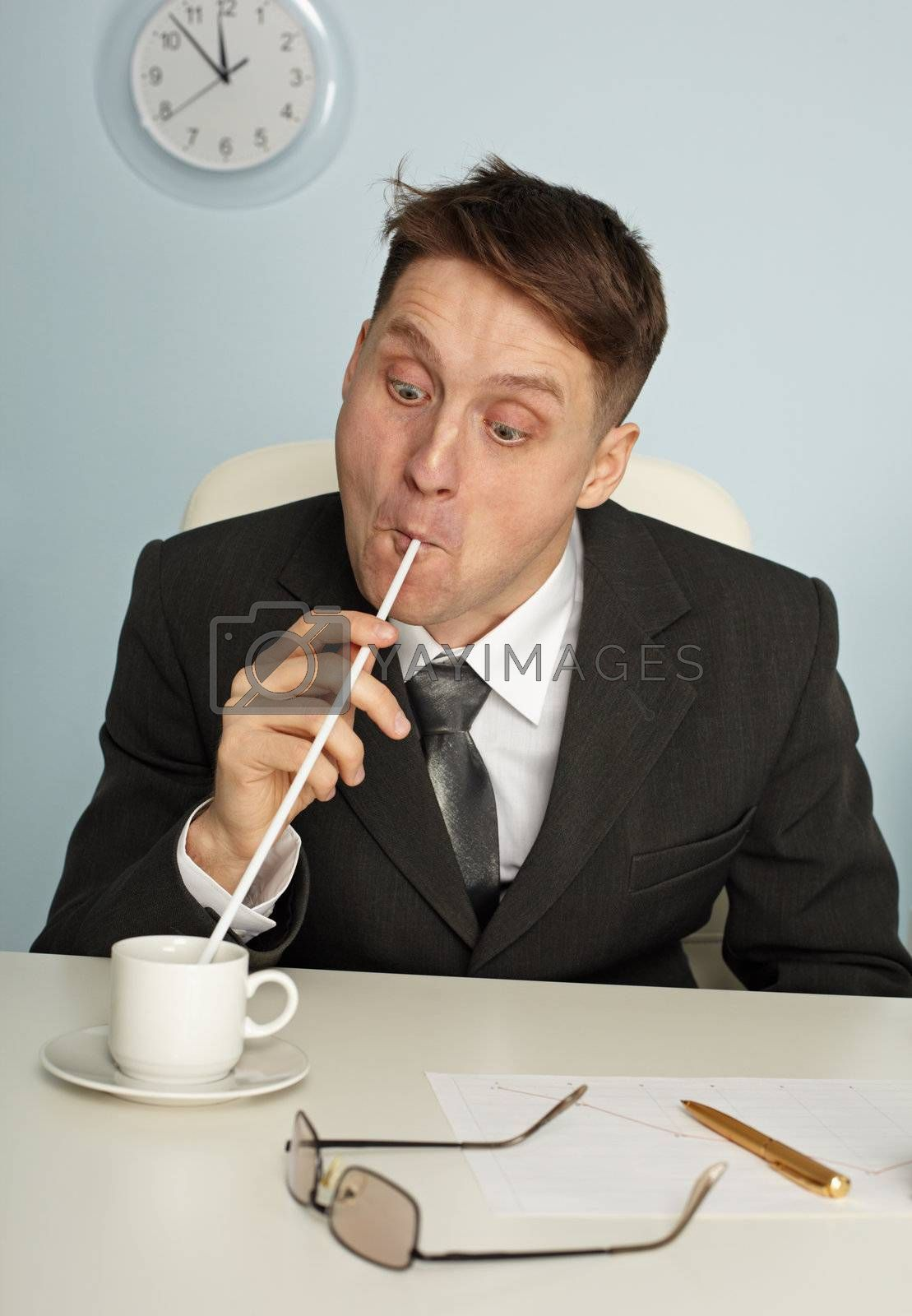 Royalty free image of Comic man drinking coffee with long straws by pzaxe