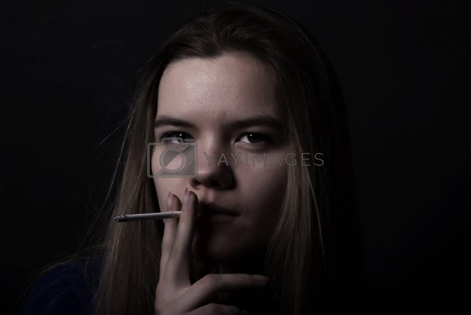 Royalty free image of Smoking girl by HASLOO