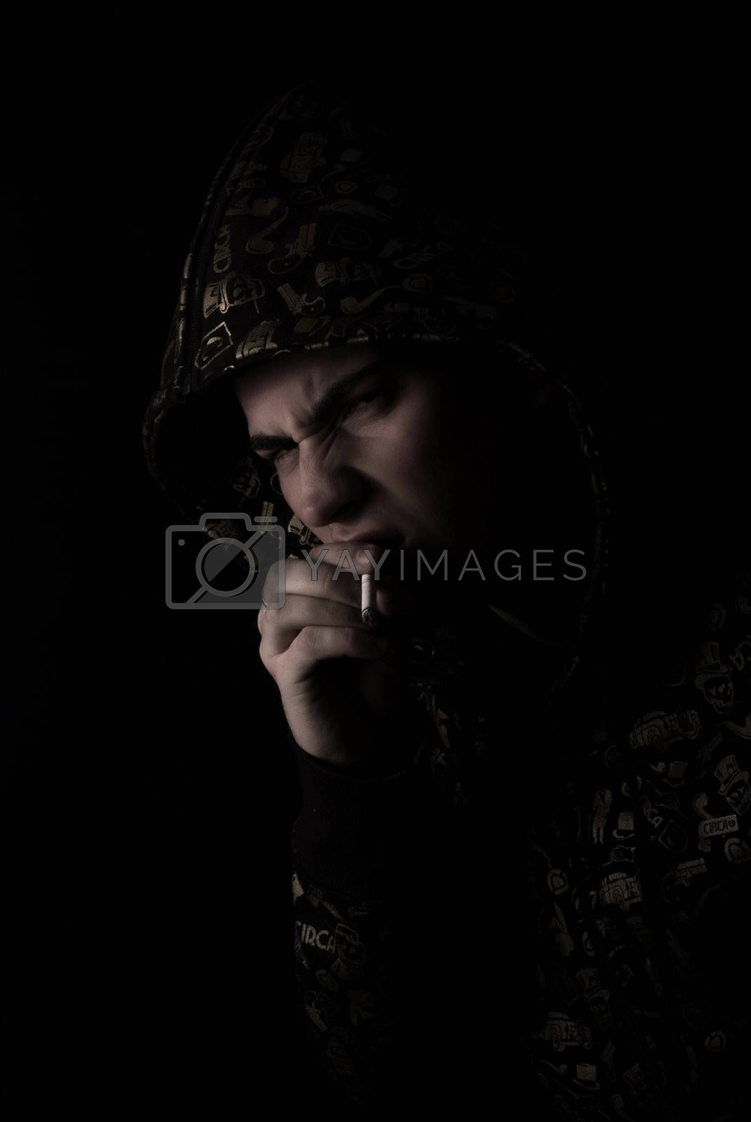 Royalty free image of portrait of a young man with cigarette   by HASLOO
