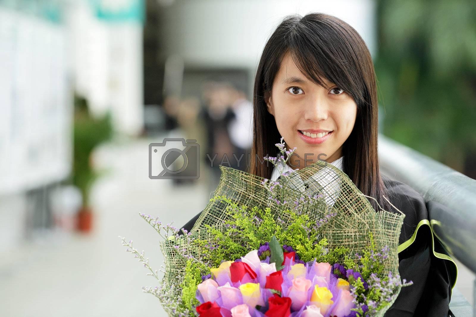 Royalty free image of asian girl graduation by leungchopan