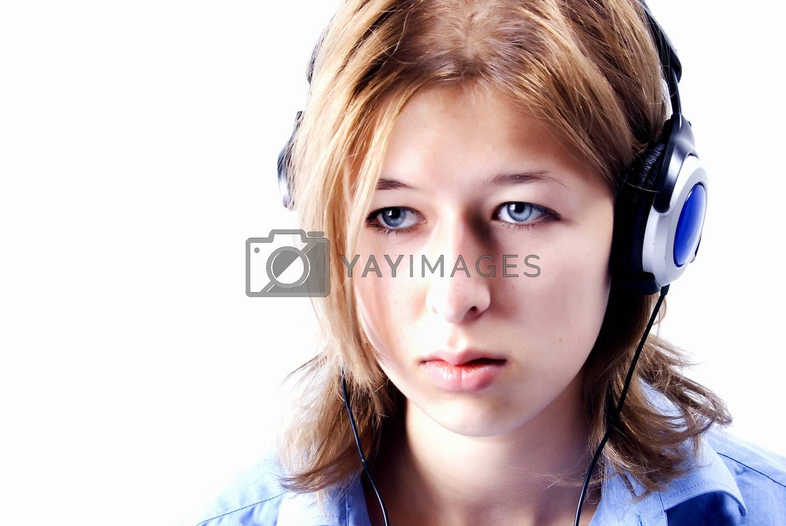 Royalty free image of Young girl in headphones    by HASLOO