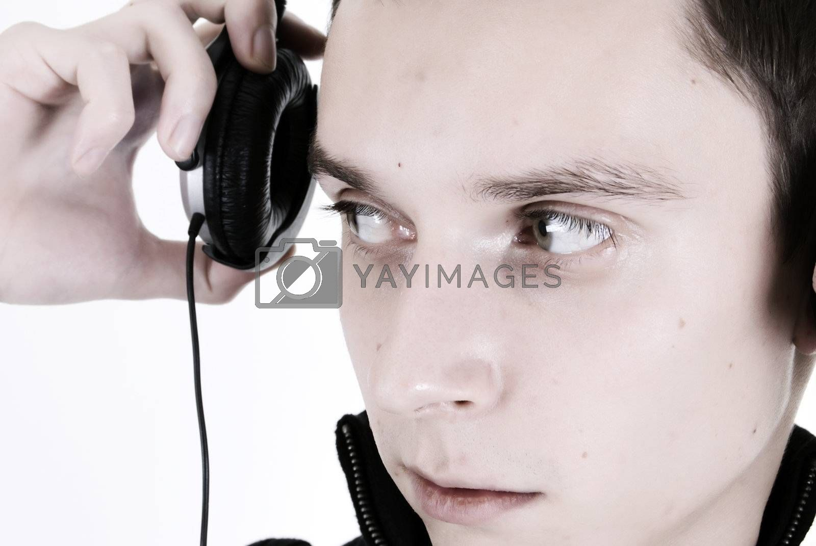 Royalty free image of Young man in headphones   by HASLOO