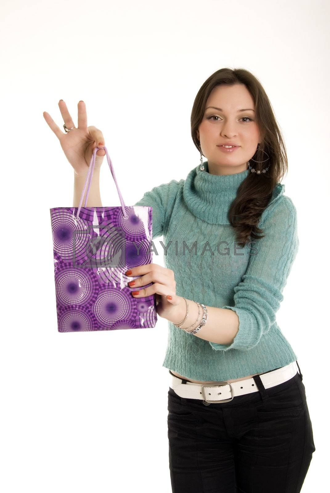 Royalty free image of Young girl with shopping bag by HASLOO