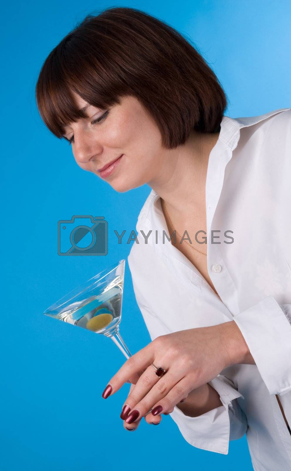 The woman in a white shirt with a glass of martini
