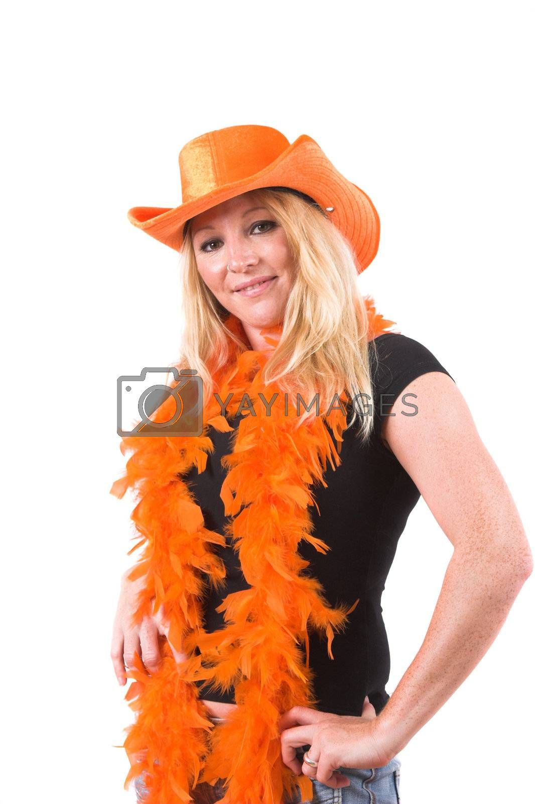 Pretty blond woman with orange hat and orange featherboa, ready to celebrate the worldcup football