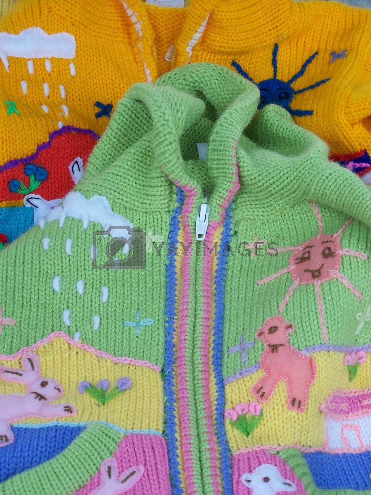 colorful baby sweaters look like spring and Easter