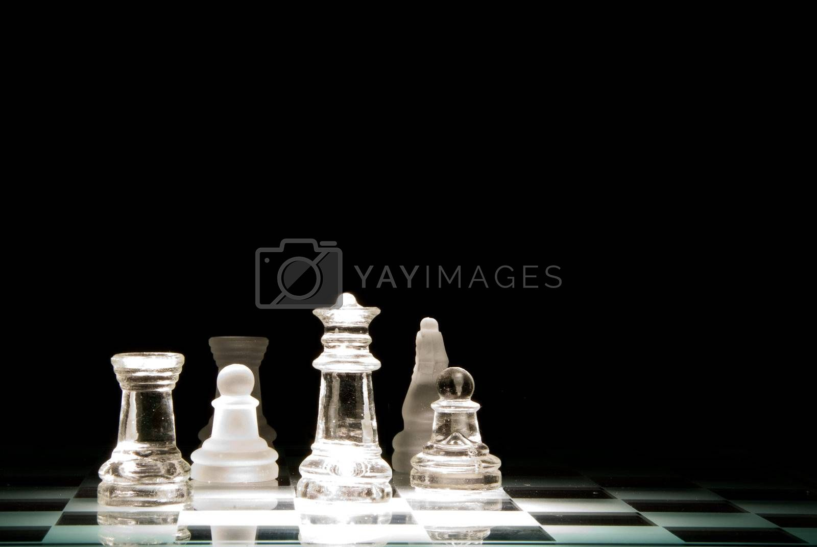 A challenging game of chess on a glass board.