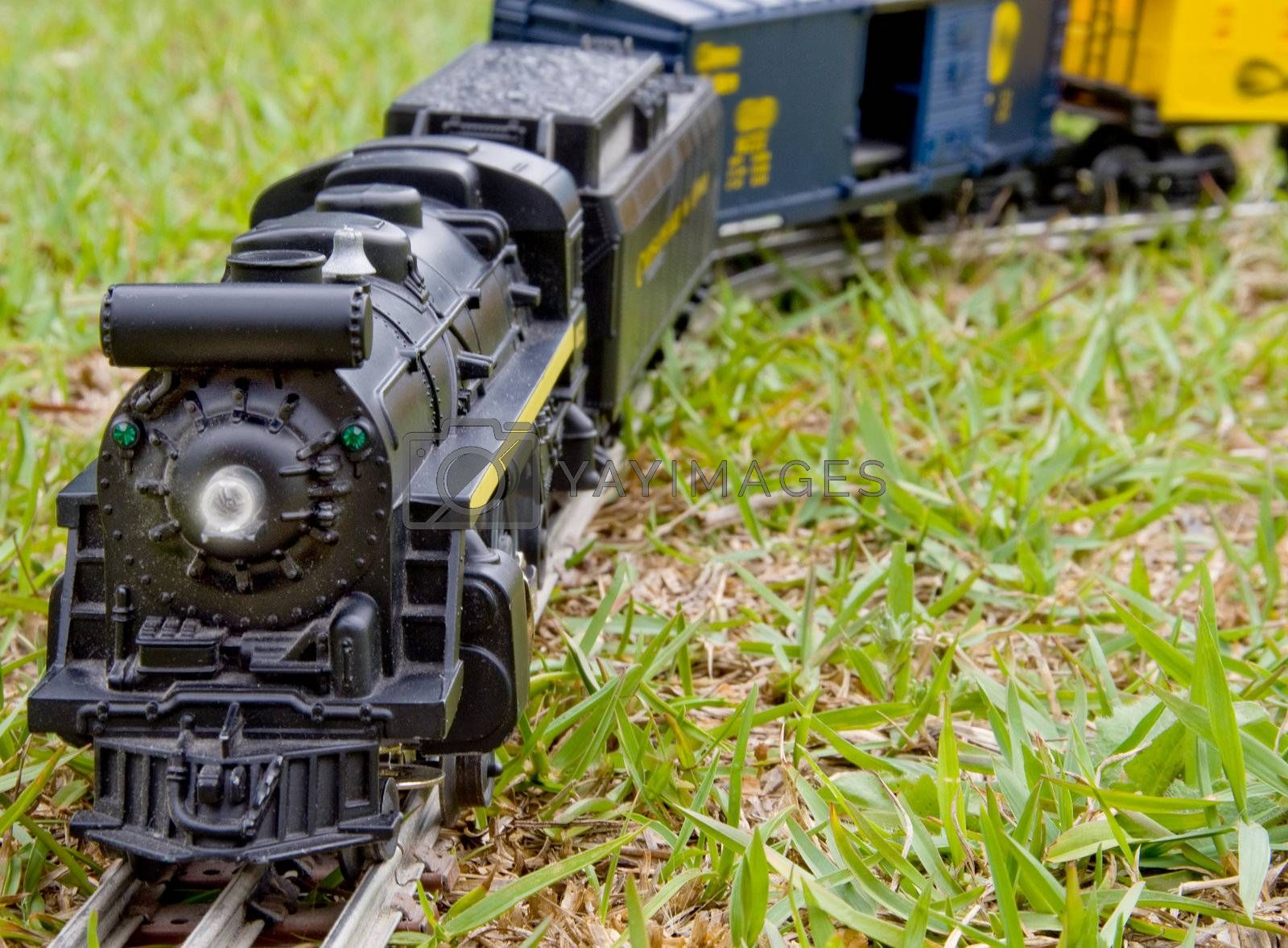 A toy train locomotive traveling across the country.