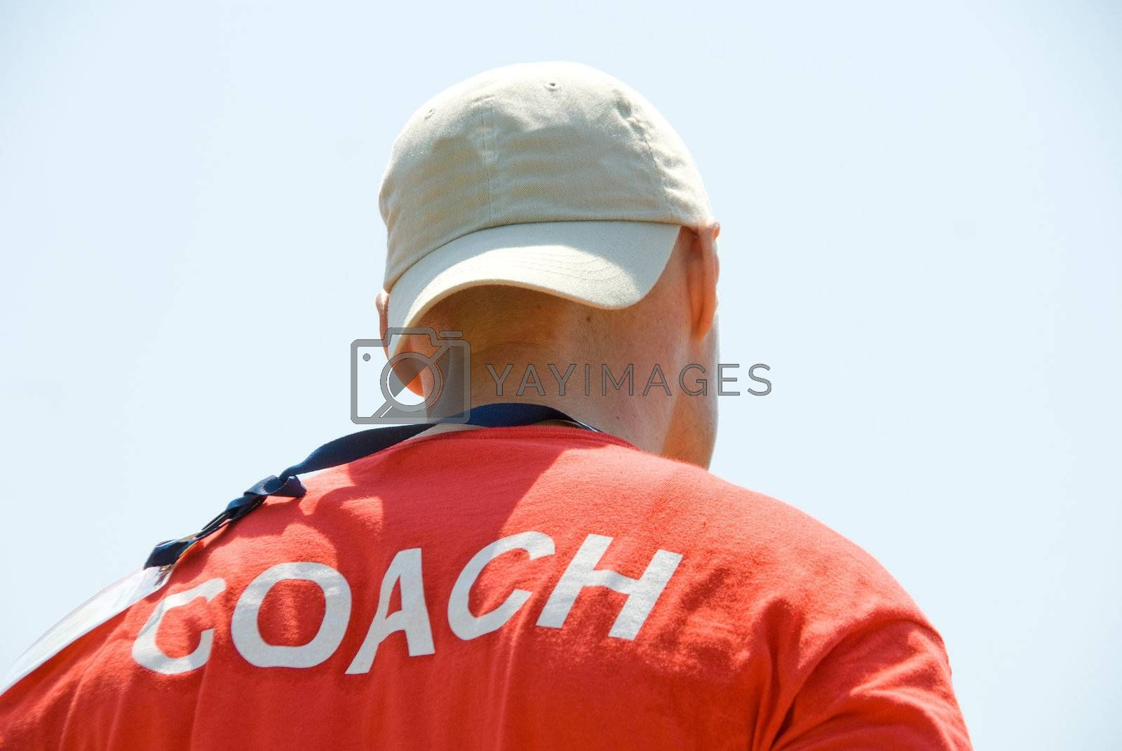 A coach getting ready to instruct his team.