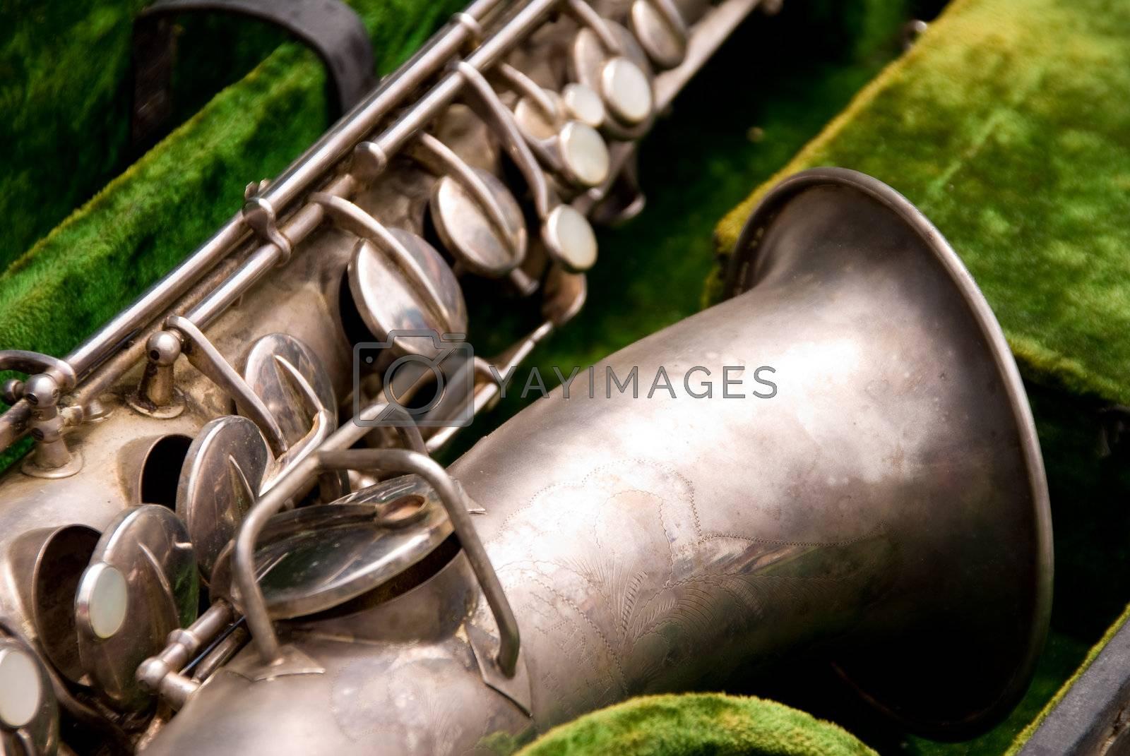 An antique horn known as a saxophone.