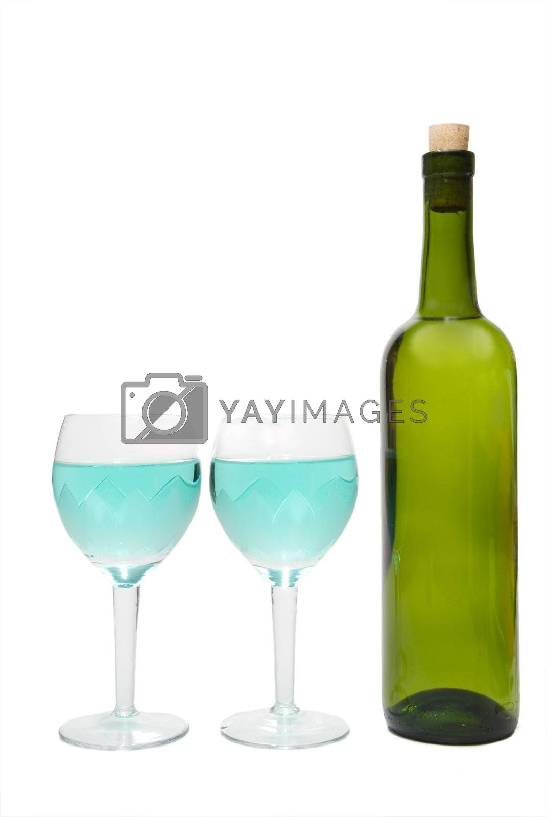 Wine in glasses and a wine bottle.