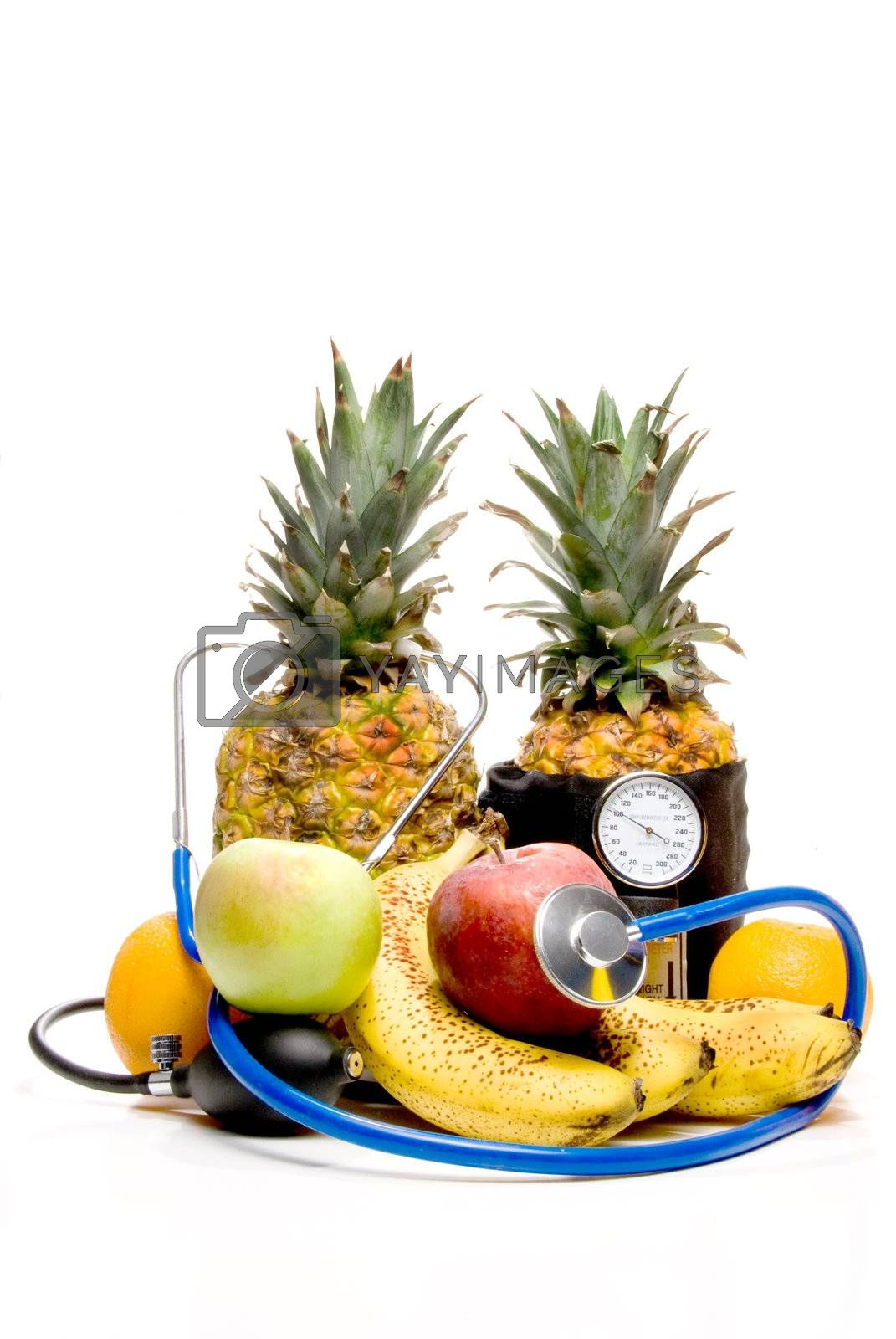 A bunch of healthy fruit getting a medical examination.