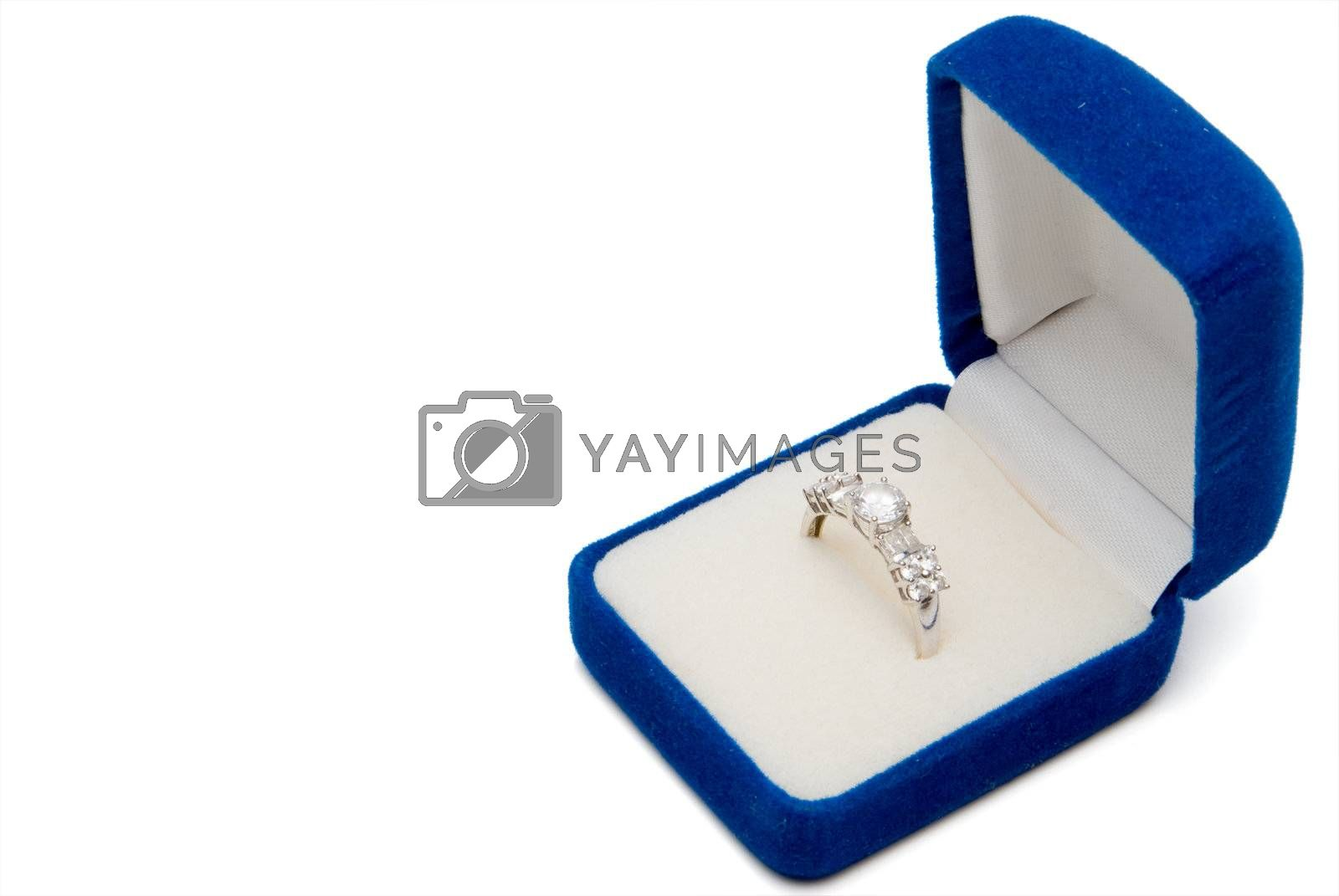 A wedding ring in a jewelers box.