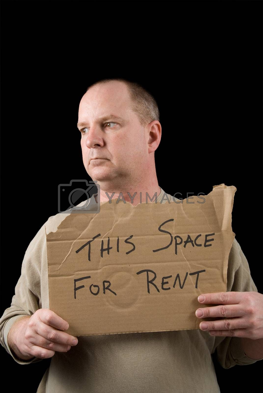 A man selling advertising space on a piece of cardboard.