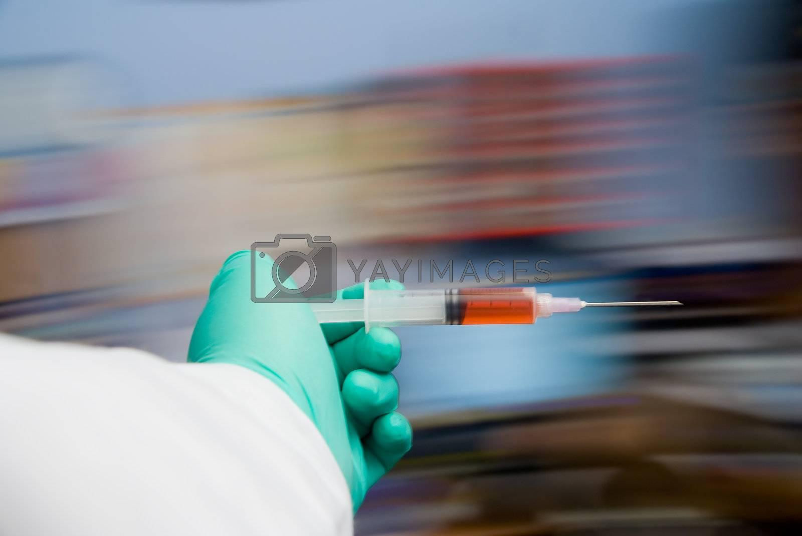 A healthcare worker holding a medical syringe.