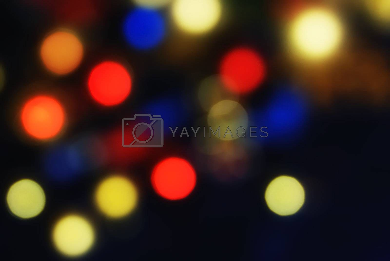 Christmas colorful background with blurred lights of xmas tree
