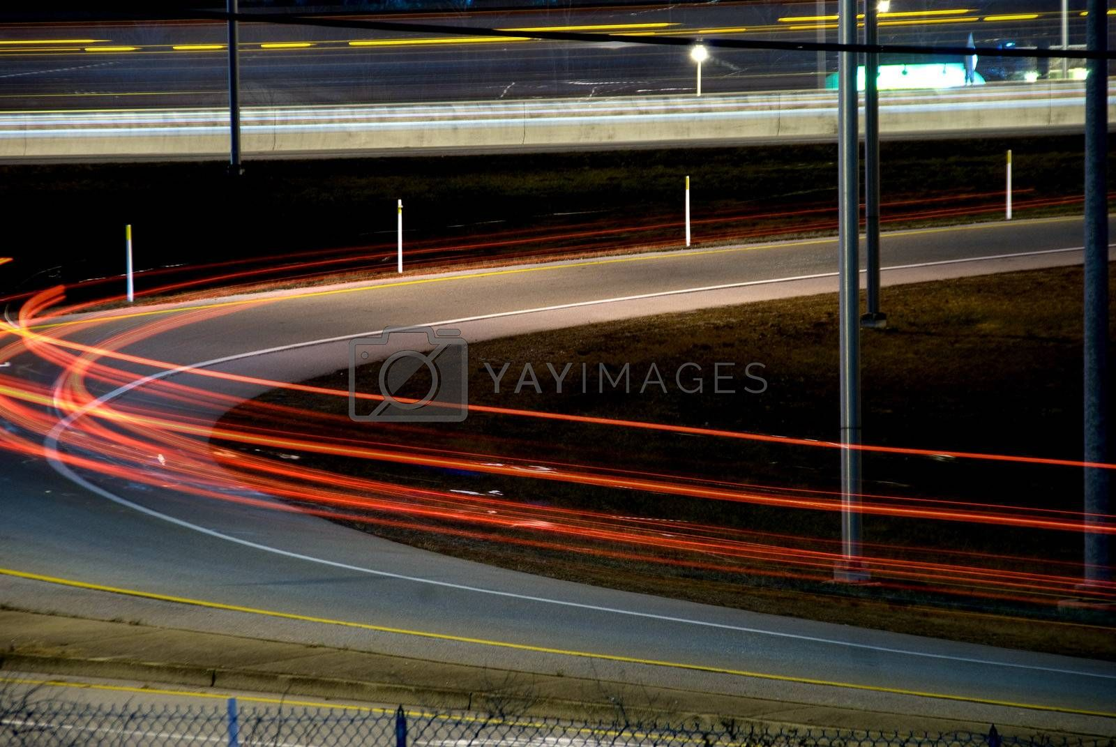 The blur of tail lights on an on ramp.