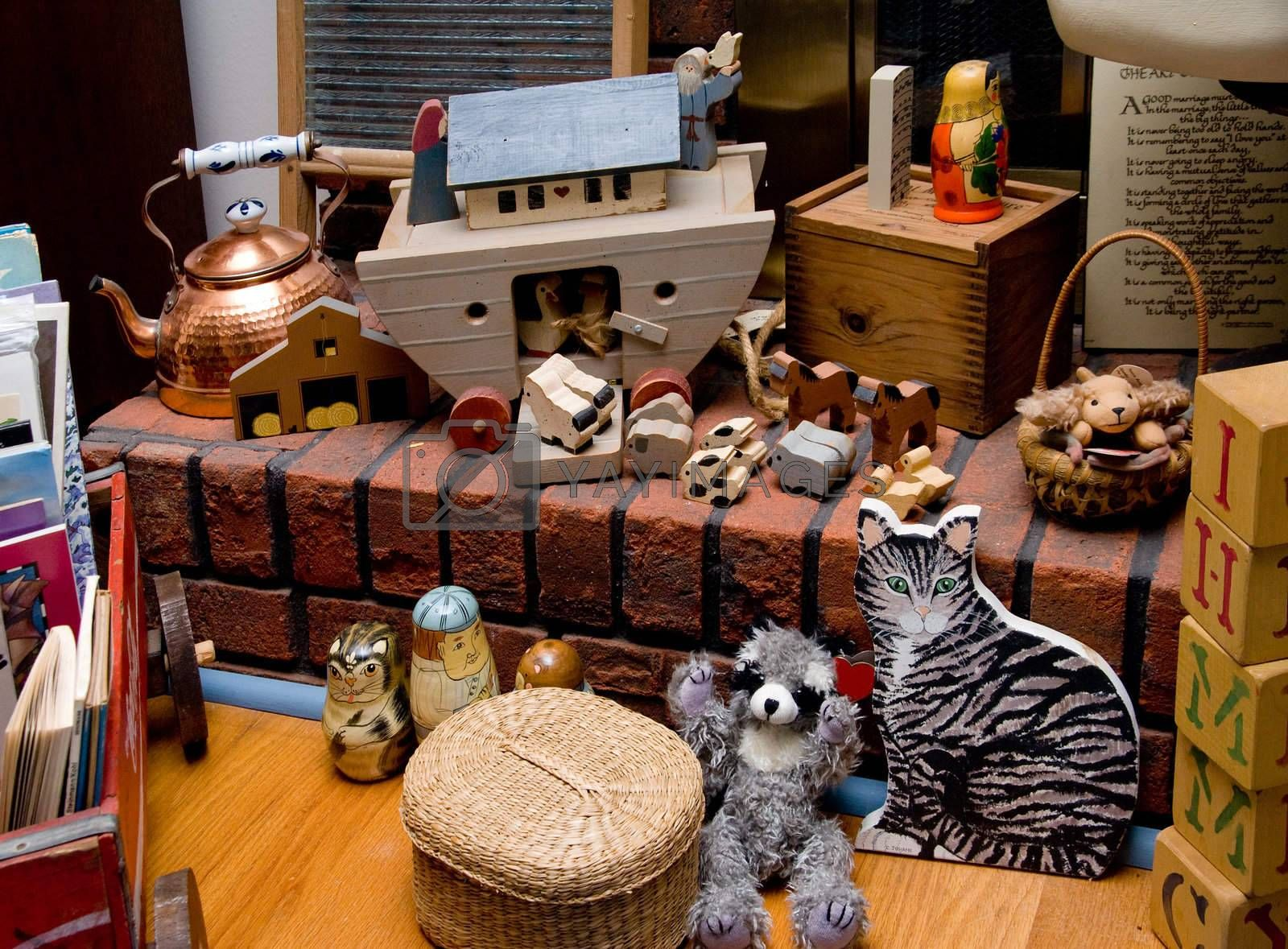 A collection of antique toys on a fireplace hearth.