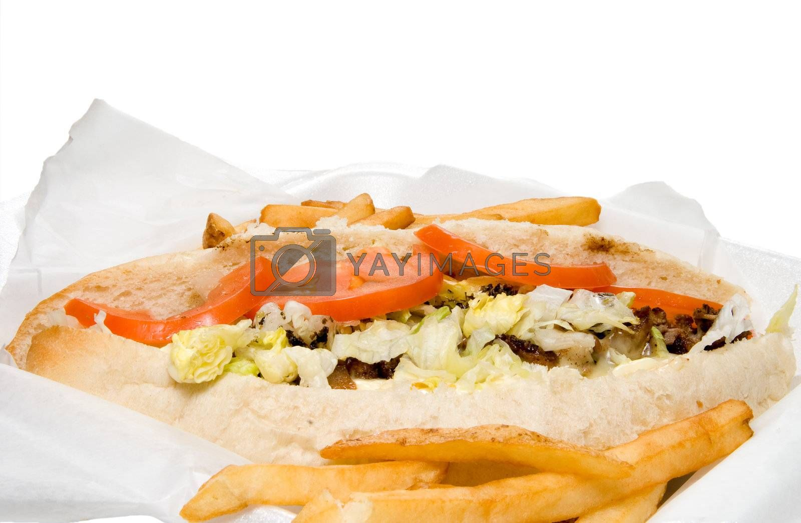 A Philly Cheesesteak and an oreder of French Fries