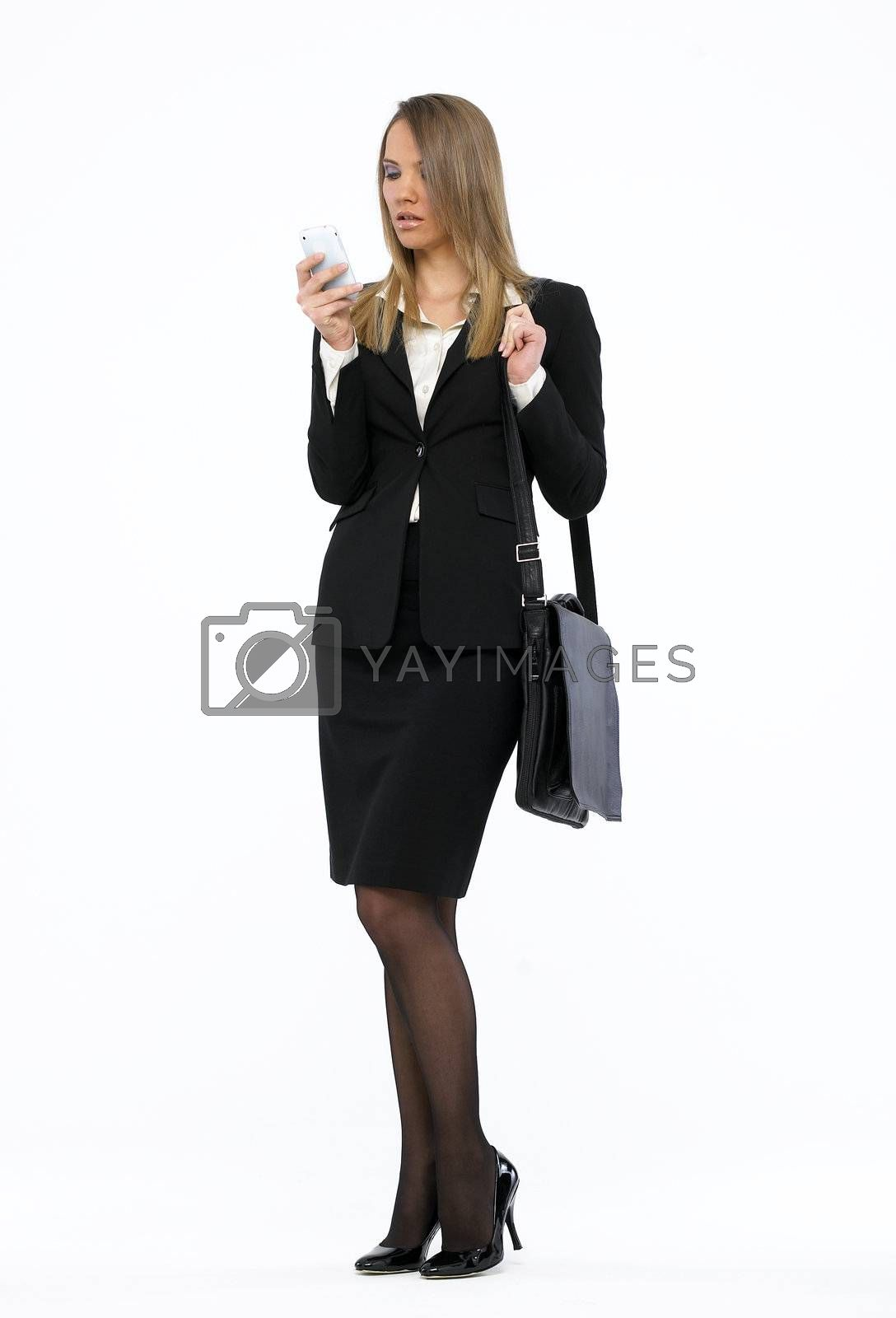 Portrait of a young attractive business woman talking on mobile phone
