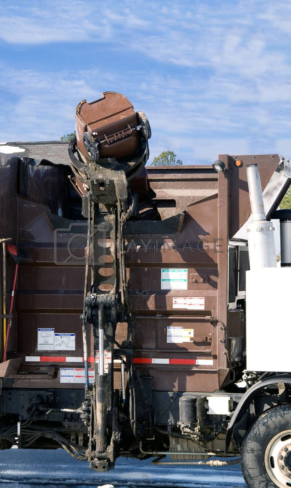 A truck emptying garbage cans.