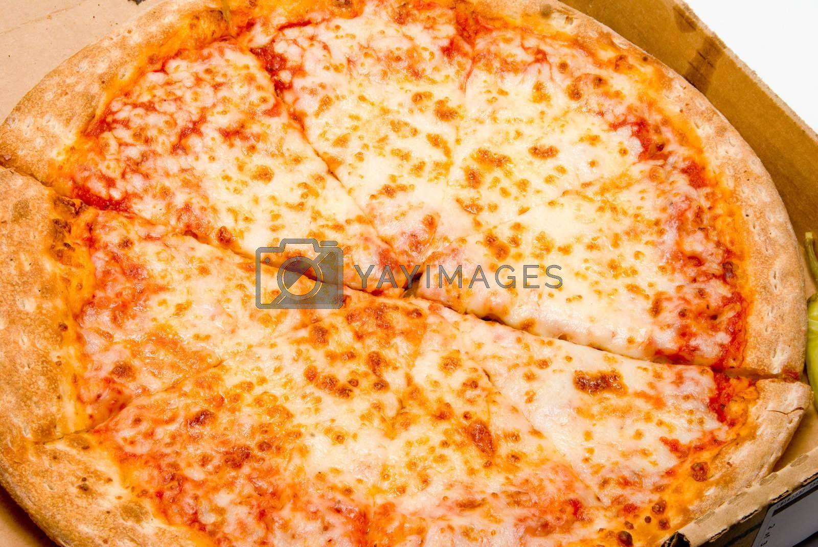 A slice of pizza ready to be eaten.