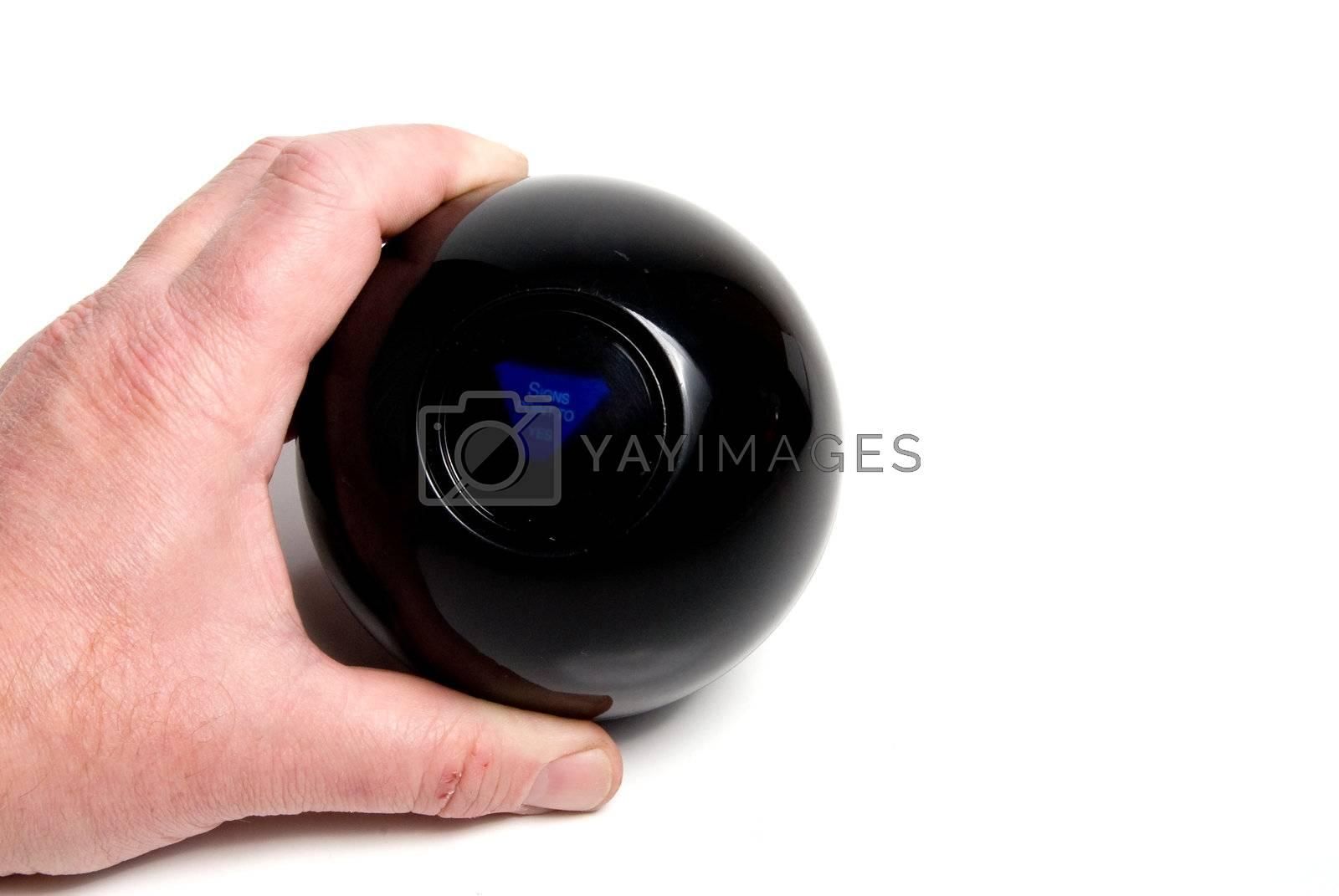 A person using a magic ball to predict the future.