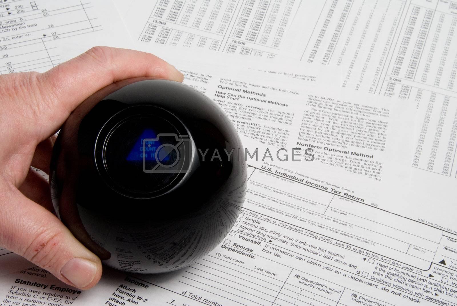 Using a magic ball to predict an incom tax outcome.