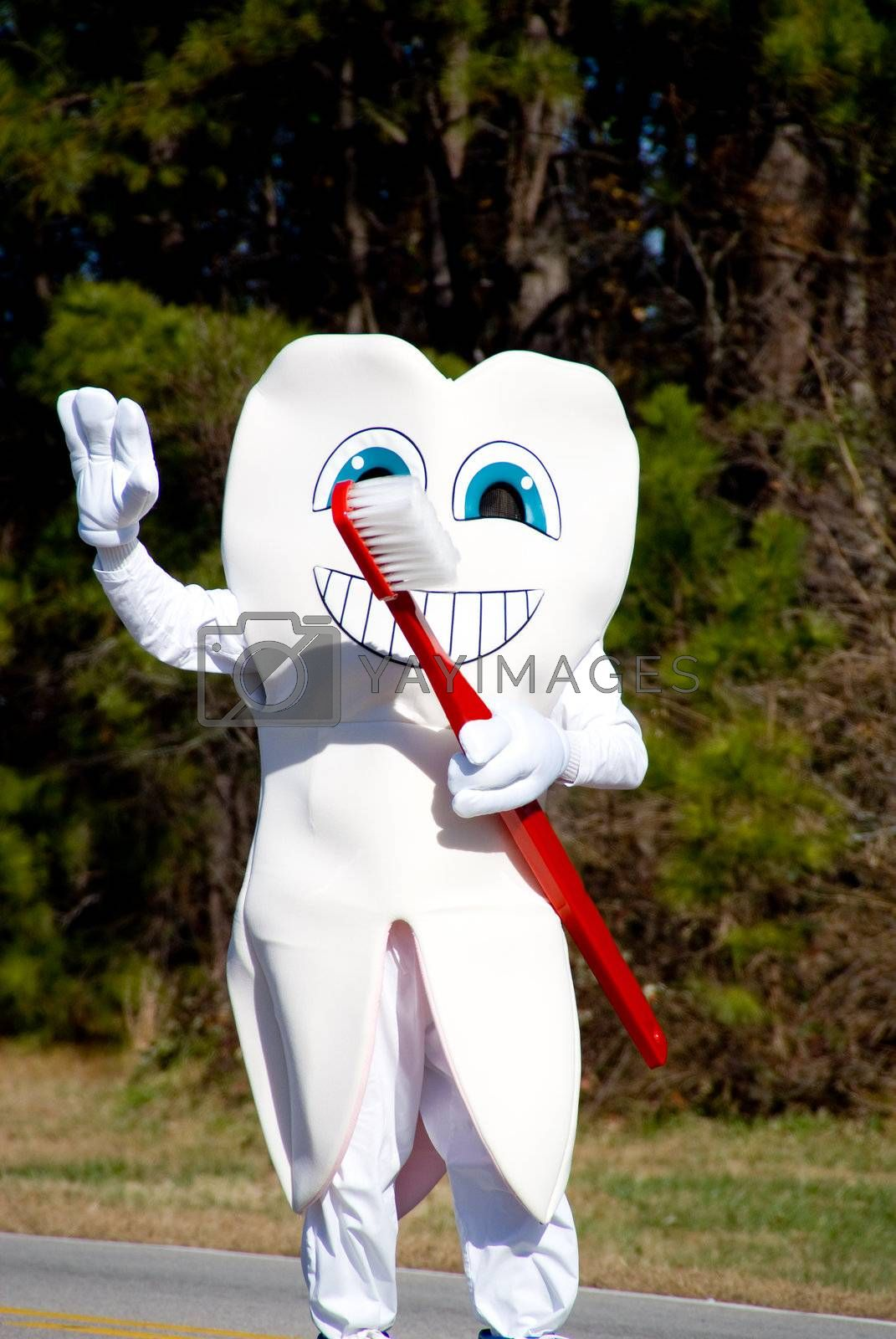 A person in a large tooth costume.