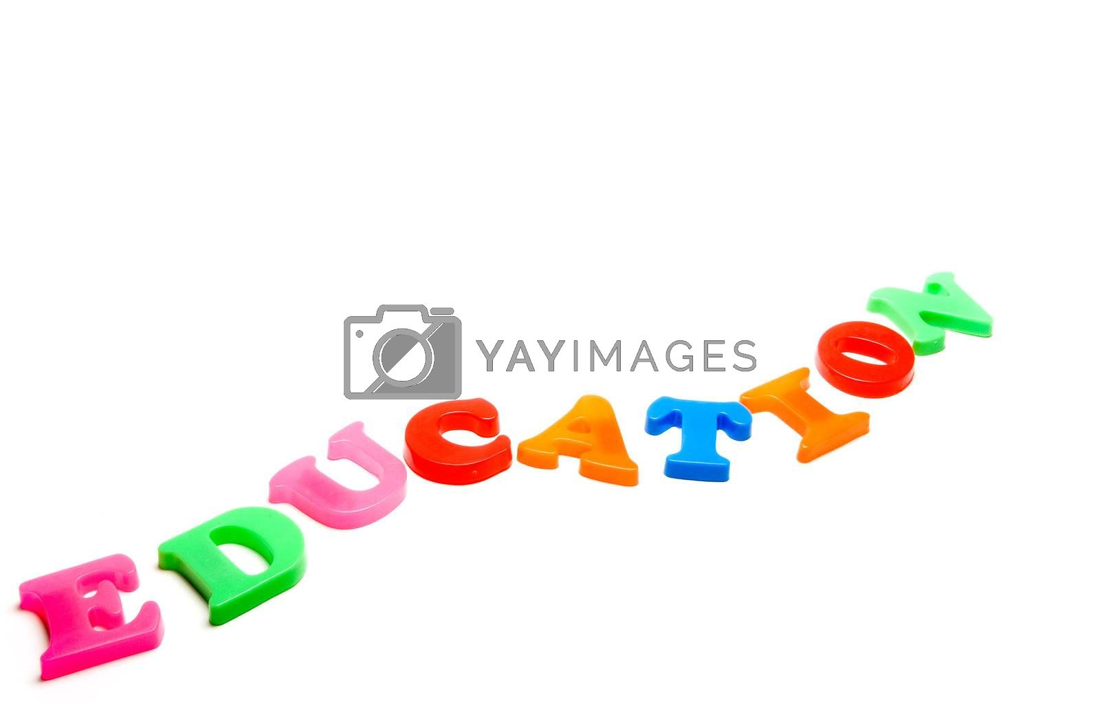Magnetic preschool letters spelling the word Education.