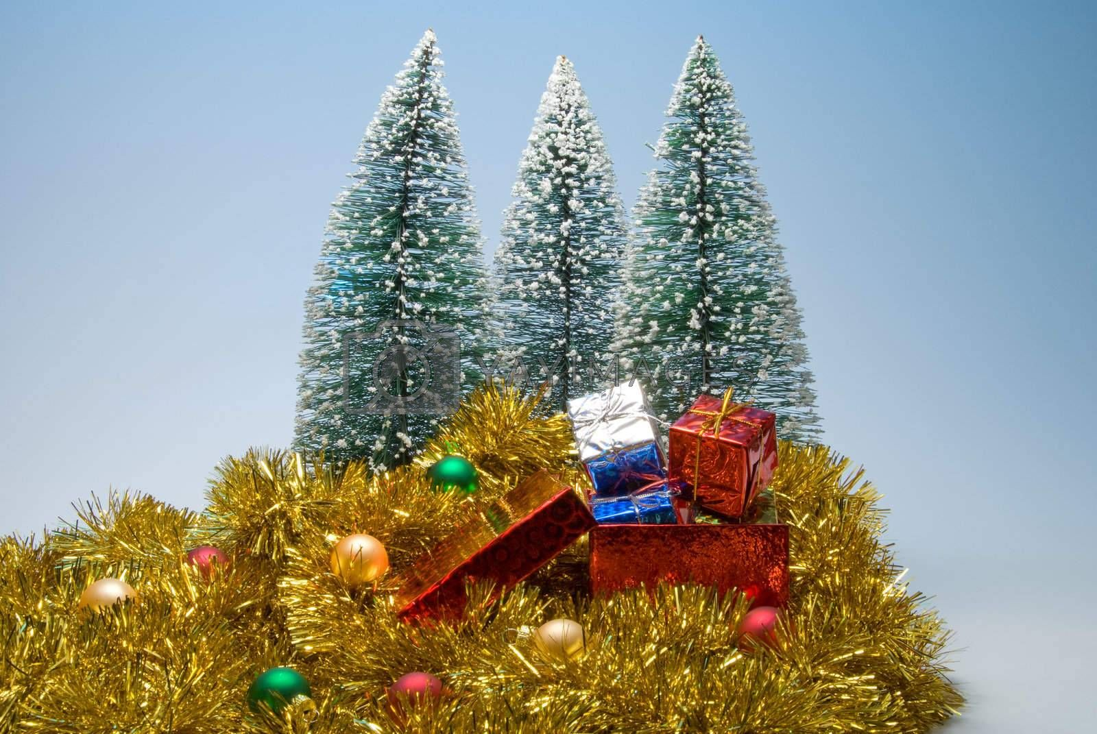Several Christmas presents in festive holiday boxes.