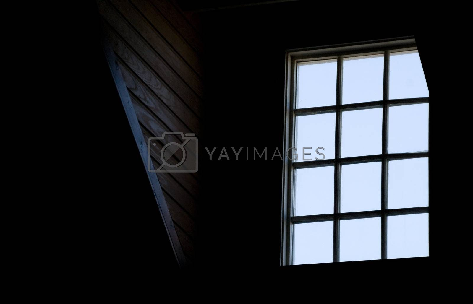 A window in the loft of an old house.