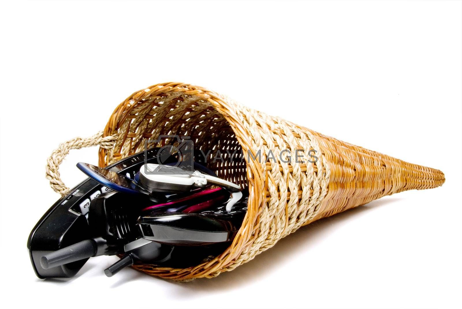A wicker cornucpia filled with communications equipment.