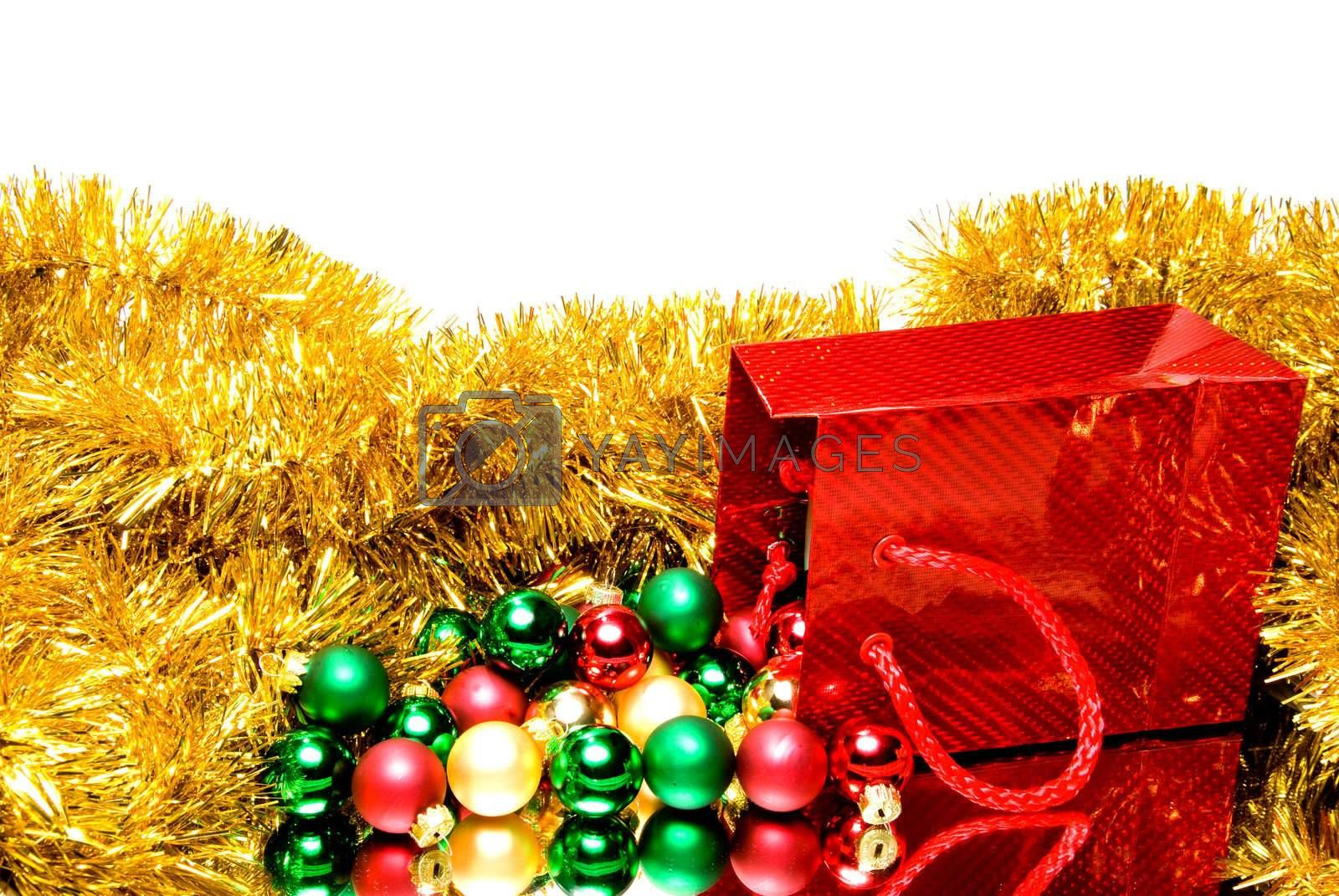 A pile of Christmas ornaments in a gift bag.