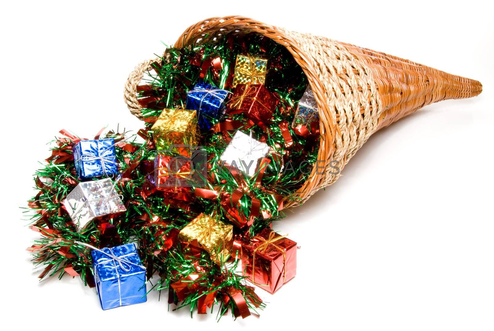 A cornucopia filled with holday Christmas presents.