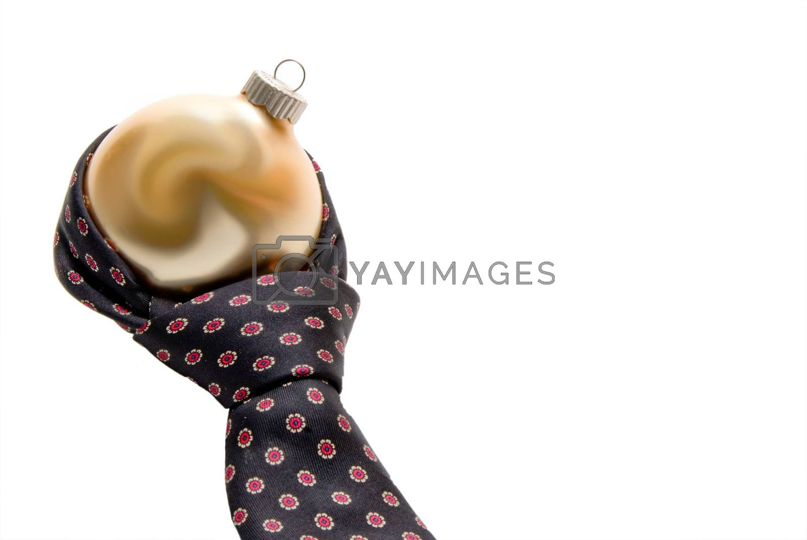 A necktie tied around a Christmas ornament.